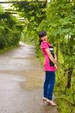 Beautiful girl and grape trellis Royalty Free Stock Photos