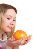 Beautiful girl with a grapefruit Stock Photos