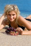 Beautiful girl with grapes Royalty Free Stock Image