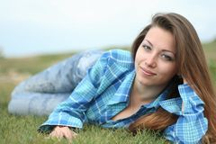 The beautiful girl on a grass Stock Photo
