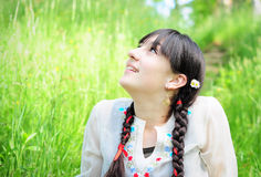 Beautiful girl in grass royalty free stock photo