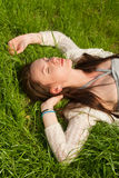 Beautiful girl on grass Royalty Free Stock Photo