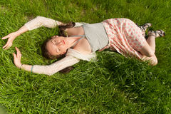 Beautiful girl on grass Stock Photo