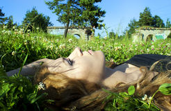 Beautiful girl in the grass Royalty Free Stock Image
