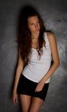 Beautiful girl gray background. Royalty Free Stock Photo
