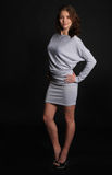 Beautiful girl in gray dress Stock Photo