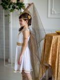 Beautiful girl in Greek dress stock image