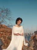 beautiful girl in a Greek dress Stock Photo