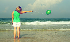 Beautiful girl with green balloon Royalty Free Stock Images