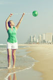 Beautiful girl with green balloon Royalty Free Stock Photos