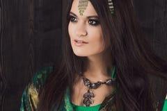 Beautiful girl in green dress dancing Oriental dance Royalty Free Stock Photos