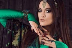 Beautiful girl in green dress dancing Oriental dance Royalty Free Stock Photo