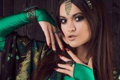 Beautiful girl in green dress dancing Oriental dance. Beautiful girl in a green dress dancing Oriental dance Stock Images