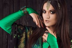Beautiful girl in green dress dancing Oriental dance Stock Photography
