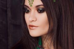 Beautiful girl in green dress dancing Oriental dance. Beautiful girl in a green dress dancing Oriental dance Royalty Free Stock Images