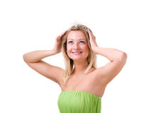 Woman in a green dress with diadem Stock Images