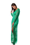 Beautiful girl in green evening gown posing against white backgr Royalty Free Stock Photography