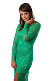 Beautiful girl in green evening gown posing against white backgr Stock Photography