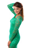 Beautiful girl in green evening gown posing against white backgr Stock Photos