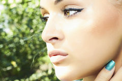 Beautiful girl with green eyes. beauty woman. nature Royalty Free Stock Photo