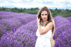 Beautiful girl with green eyes enjoying the scent of lavender Royalty Free Stock Images