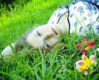 The beautiful girl with green eyes on a grass Royalty Free Stock Image