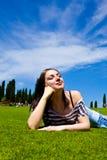 Beautiful Girl on green field Royalty Free Stock Photo