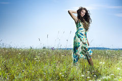 Beautiful girl in green field Royalty Free Stock Photography