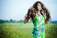 Beautiful girl in green field Stock Photography