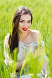Beautiful girl at the green field of rye Stock Photography