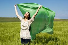 Beautiful girl at the green field of rye Royalty Free Stock Image
