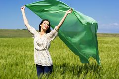 Beautiful girl at the green field of rye Stock Photo