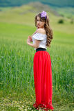 Beautiful girl on green field in spring Royalty Free Stock Photography