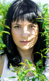 Beautiful girl in green foliage Royalty Free Stock Photography