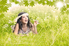 Beautiful girl in green garden Stock Image