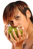 Beautiful girl with green grape Stock Images