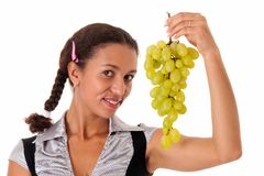 Beautiful girl with green grapes Stock Photography