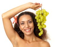 Beautiful girl with green grapes Royalty Free Stock Image