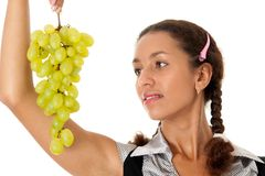 Beautiful girl with green grapes Stock Images