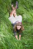 Beautiful girl on green grass Stock Images