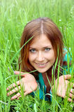 Beautiful girl in a green grass Royalty Free Stock Photos