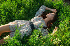 Beautiful girl on the green grass Royalty Free Stock Photography
