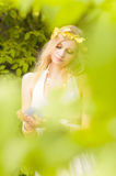 Beautiful girl and green leaves Royalty Free Stock Images
