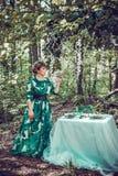 Beautiful girl in a green long dress. stock photos