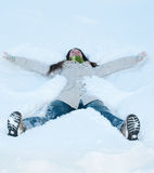 Beautiful girl in green lying in snow Royalty Free Stock Images