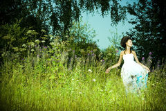 Beautiful girl in green meadow Stock Photography