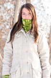 Beautiful girl in green over winter landscape Royalty Free Stock Images