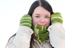 Beautiful girl in green over winter landscape Stock Photo