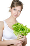 The beautiful girl with green salad Stock Photography