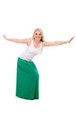 Beautiful girl in a green skirt to with his hands spread apart Stock Photography